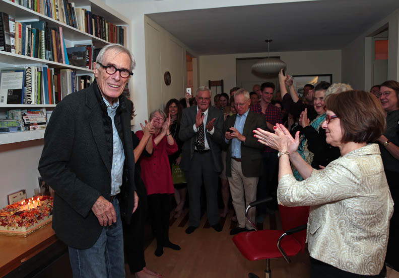 Mark Strand celebrating his 80th birthday with friends in April of 2014. Strand would pass away later that year in November.