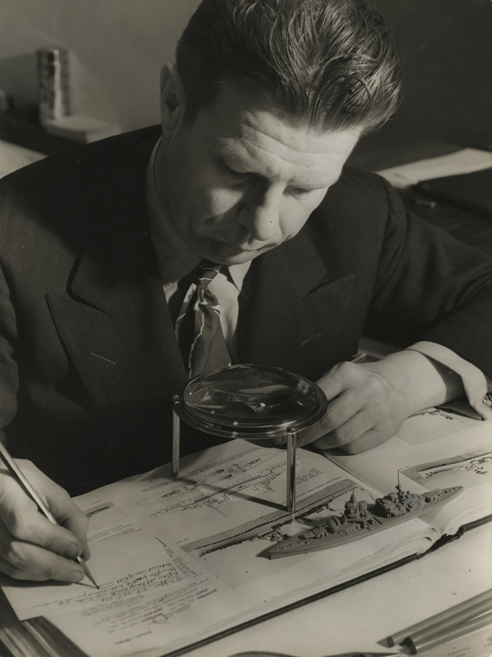 "Norman Bel Geddes, with some of his scale model ships that he used in ""wargaming."""