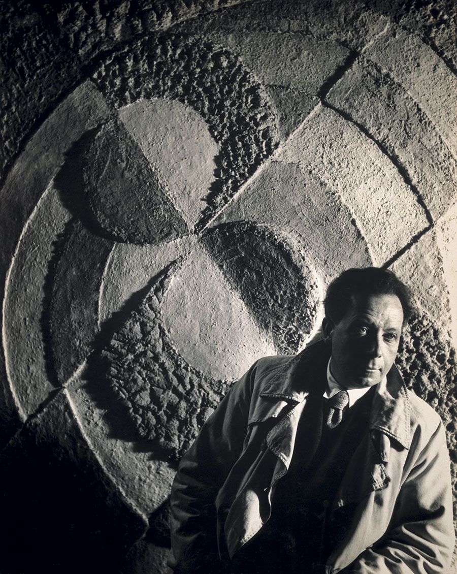 "Robert Delaunay posing in front of his ""Rythmes San Fin,"" 1935. (Photo by Florence Henri)"
