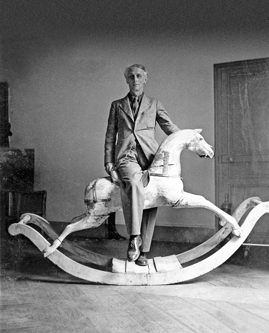 Max Ernst with rocking horse, 1938