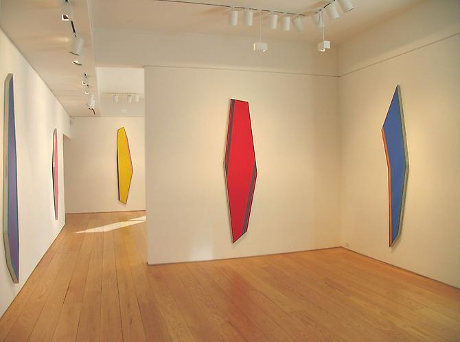 "From the 2010 exhibition ""Shaped Paintings"" at the Leslie Feely gallery in New York City - a view of the gallery with several of Noland's shaped canvases from 1981-82"