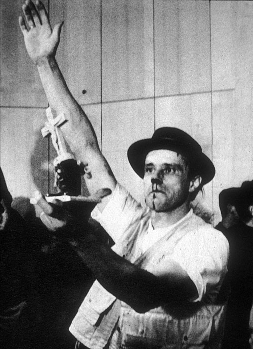 Joseph Beuys, bloodied after