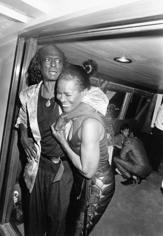 Miles Davis affectionately wraps his arm around his wife Cicely Tyson as they celebrate Davis's 60th birthday.