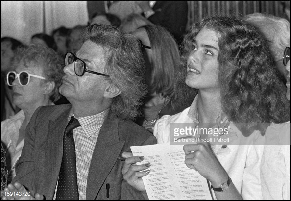 Richard Avedon and Brooke Shields attend the presentation of Yves Saint Laurent's Fall Winter Collection, 1980