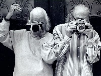 Bassman and Himmel in their later years, taking a dual self-portrait.