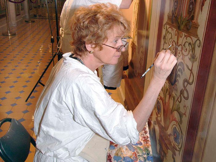 Conservator Christiana Cunningham-Adams seen here working on restoring Brumidi's frescoes. (photo: Architect of the Capitol)
