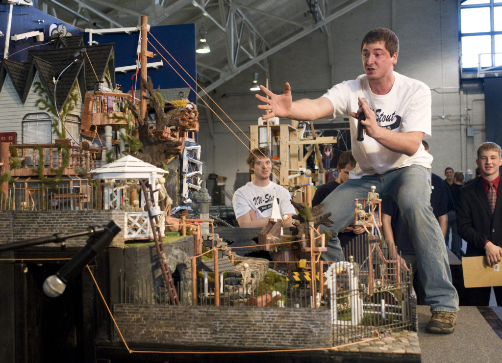 Andrew Behnke, captain of the University of Wisconsin-Stout team, explains the workings of the team's winning Rube Goldberg machine. (Purdue University photo/Mark Simons)