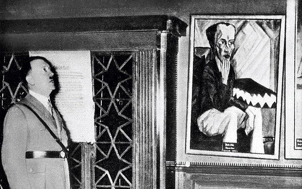 "One of Heckel's works being inspected at the ""Degenerate Art"" exhibition"