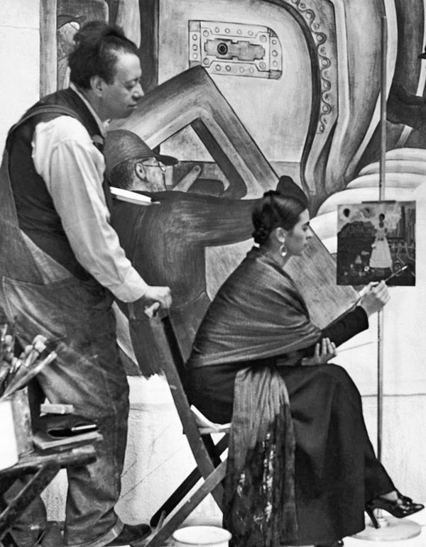 "Frida working on a painting of her own, while Diego worked on the mural ""Man At The Crossroads,"" 1933"