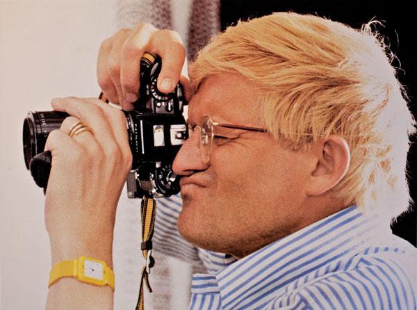 Hockney with camera, photo by Paul Joyce