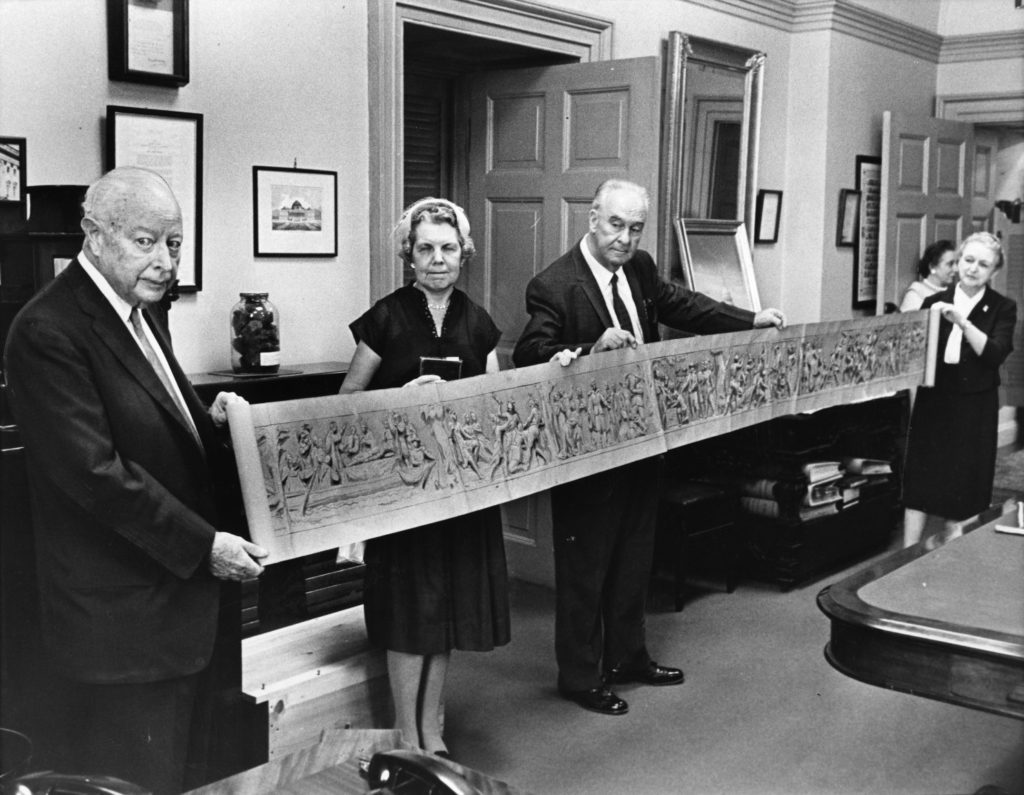 Myrtle Cheney Murdock (seen on the right, holding the end of the painting), at the ceremony for Brumidi's painted study for the Capitol frieze was to be donated to the Smithsonian Institution