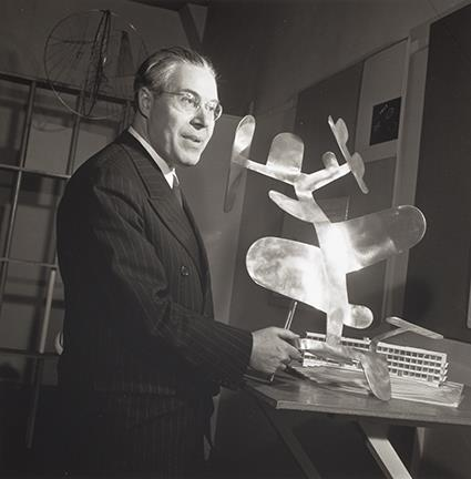 With one of his sculptures, 1945, at the Institute Of Design, Chicago