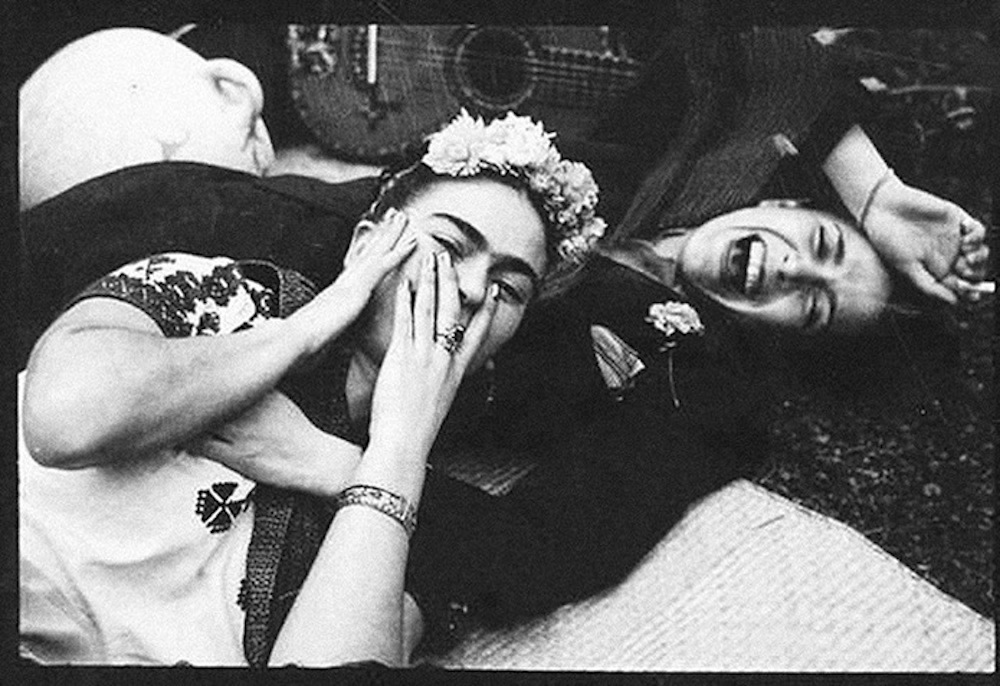 A beautiful, rare moment captured by Tina Modotti: Frida Kahlo laughing, with singer Chavela Vargas