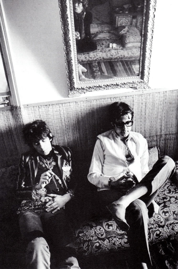 Keith Richards of the Rolling Stones (left) and Robert Fraser, relax and enjoy something delightful, in Morocco, 1966. Photo by Michael Cooper