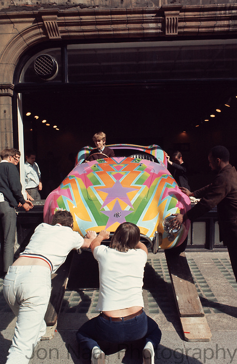 Honorable Tara Browne, friend of the Beatles in his psychedelic-painted AC Cobra exiting window of Robert Fraser Gallery, 1966