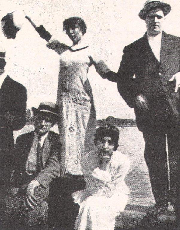Marie Laurencin (waving) holding the arm of her companion, Guillaume Apollinaire, c. 1915