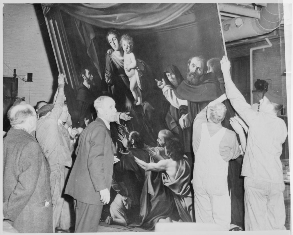 "1950 - Workmen at the Museum Of Modern Art in New York, uncrating the ""Madonna Of The Rosary,"" by Caravaggio"