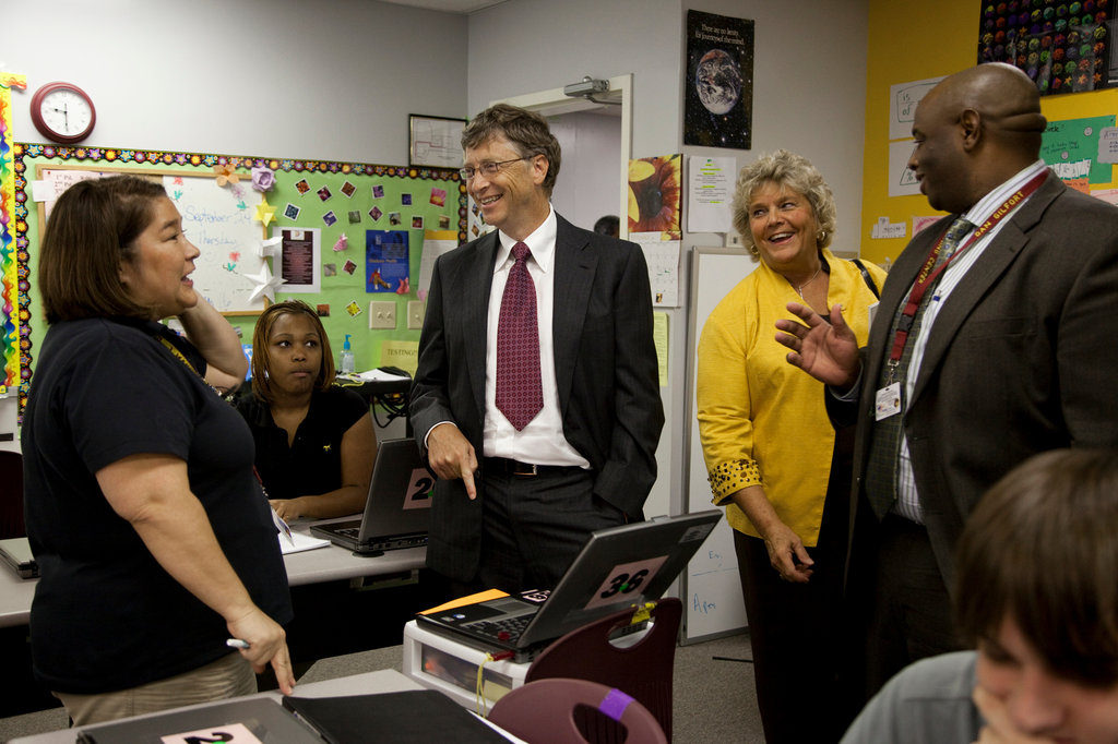 Bill Gates, center, speaks with a teacher during a 2009 classroom visit at the Durham Performance Learning Center in Durham, N.C - photo by David Evans