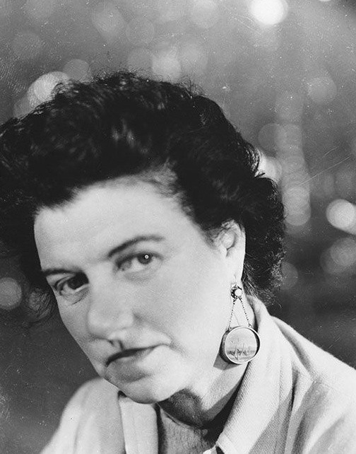 Peggy Guggenheim, c. 1950, wearing earrings painted by Tanguy