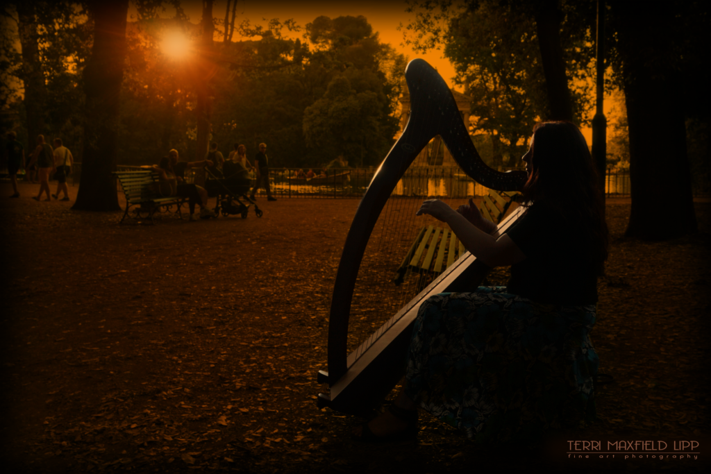 Harpist Giovanna Ofelia Berardinelli, playing in the gardens of Villa Borghese, Rome, Italy